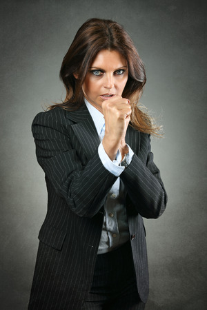 resolute: Resolute manager woman ready for the fight. Business competition concept