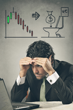 power of money: Worried businessman in front of monitor losing on financial markets . Money wasted conceptual Stock Photo