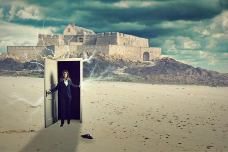 Shocked woman opens a door and find herself on a strange beach . Surreal and weird conceptual