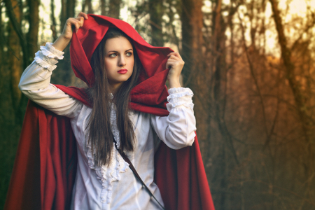 Little red riding hood alone in the dark Stock fotó