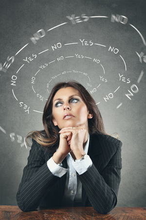 indecision: Beautiful woman thinking between yes or no  . Indecision conceptual