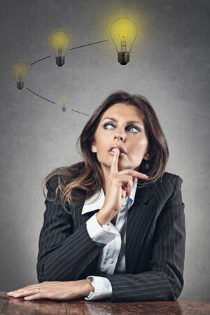 finance problems: Good idea growing in a business woman head . Problem solving and creativity