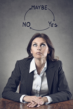 Elegant business woman decision making . Grey backdrop