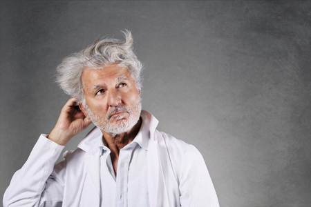 White hairs scientist thinking . Knowledge and research Standard-Bild