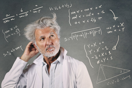 White hairs scientist with mathematics formulas . Knowledge and research Standard-Bild