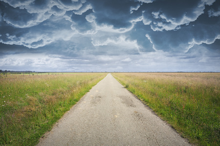 photomanipulation: Country road and dramatic cloudscape  Background for photomanipulation Stock Photo
