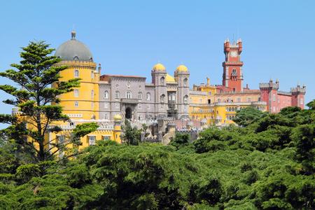 Fairy castle of Palacio da Pena among the trees. Sintra , Portugal