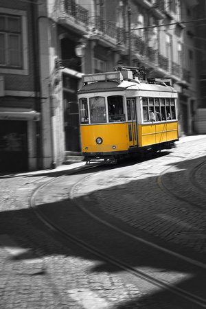 electrico: Famous and retro Tram number 28 in Lisbon , Portugal .