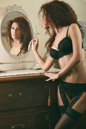 boudoir: Beautiful lingerie model reflected in the mirror . Glamour and boudoir  Stock Photo