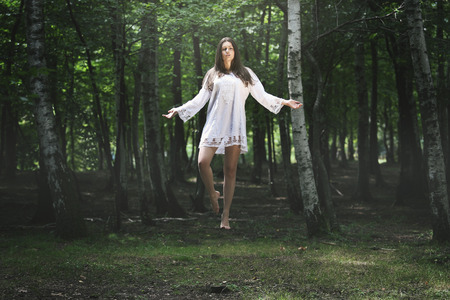 levitation: Beautiful woman levitation in the forest . Fantasy and surreal