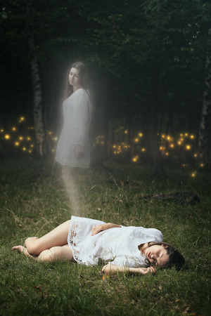 women body: Soul of a dead girl is leaving her body. Forest spirits are waiting