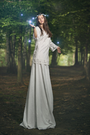 fairy woman: Fairy woman in magical forest with spirits . Fantasy and surreal concept Stock Photo