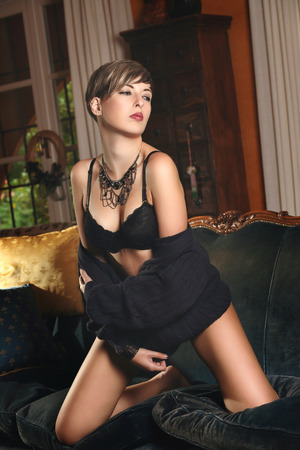 teasing: Sensual pose of a short hair model . Romantic and sexy Stock Photo
