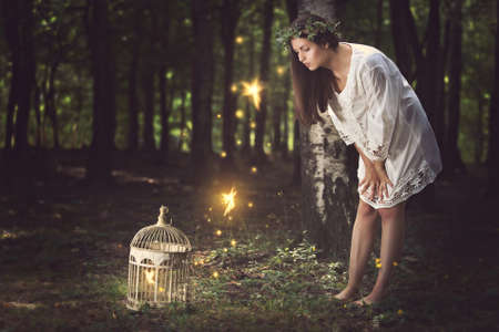 Beautiful young woman with her fairy friends . Fantasy concept Stock Photo