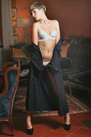 3159f5de5086 #33876560 - Bella modelo posando con elegante abrigo y ropa interior  blanca. Retrato sensual