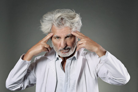 mad scientist: White hair mad scientist deeply focused . Knowledge and research