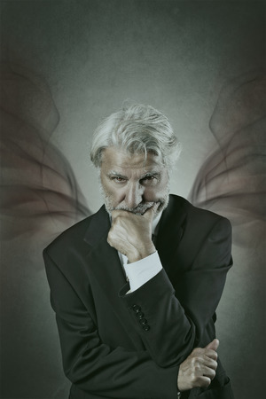 devilish: Devilish portrait of a mysterious old man with sharp look Stock Photo