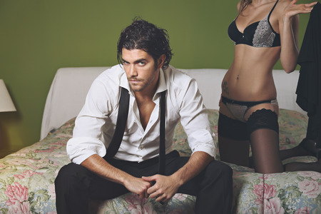 Handsome elegant man with woman body in lingerie . Fashion posing photo