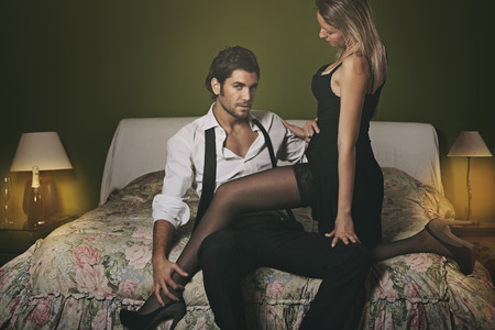 sexy couple in bed: Dark fashion portrait of handsome man and woman .Sensual Valentine day Stock Photo