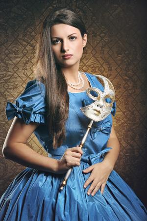 velvet dress: Beautiful woman in blue historical dress with venetian mask . Venice carnival portrait Stock Photo