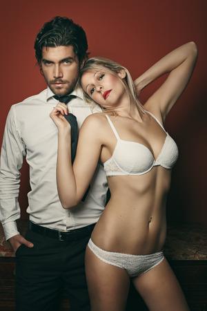 seduce: Beautiful fashion couple portrait . Woman in lingerie Stock Photo