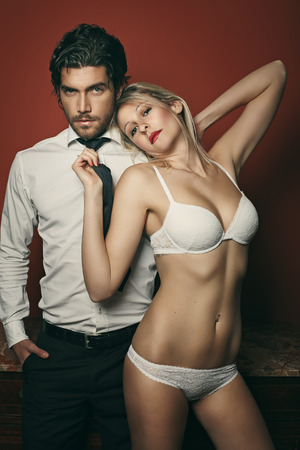 Beautiful fashion couple portrait . Woman in lingerie Stock Photo