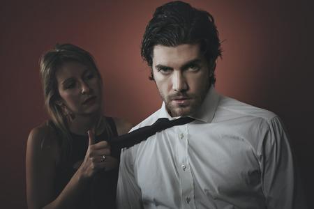 possessive: Handsome fashion man portrait with dark tones . Possessive seduction