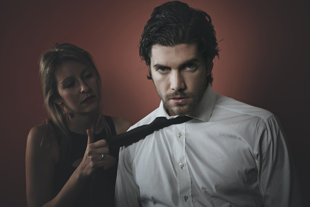 Handsome fashion man portrait with dark tones . Possessive seduction