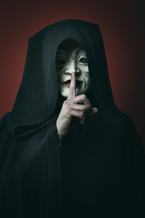 pierrot: Mysterious pierrot masked man . Silence gesture pose Stock Photo