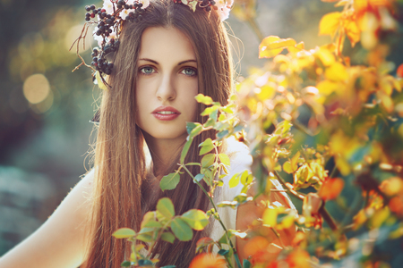 fairy garden: Beautiful woman in spring light and colors. Seasonal portrait Stock Photo
