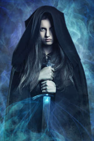 lights: Beautiful dark woman surrounded by magical powers . Fantasy and legend