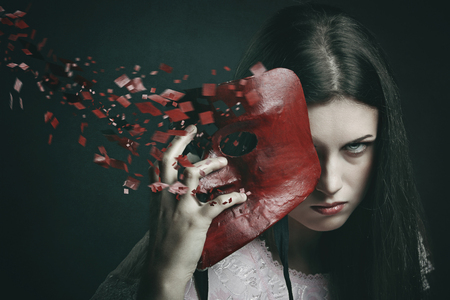 Beautiful dark woman with scattered venetian mask . Surreal and fantasy concept Stock Photo