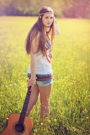 hippy: Beautiful hippie woman with guitar . Summer colors portrait