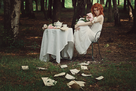 beautiful redhead: Beautiful redhead woman lost in her thoughts. Vintage colors Stock Photo