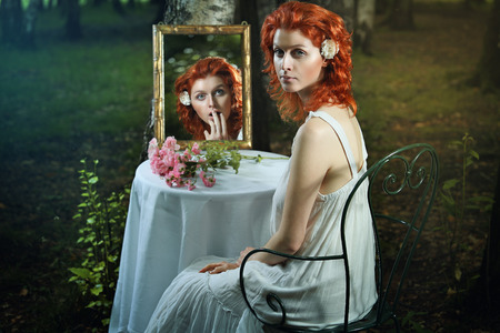 Shocked expression in a strange mirror . Surreal and fantasy concept
