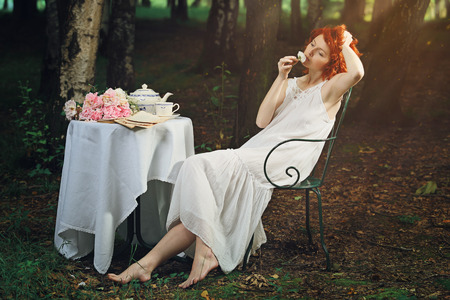 wood nymph: Beautiful redhead woman in romantic surreal forest . Vintage fantasy portrait