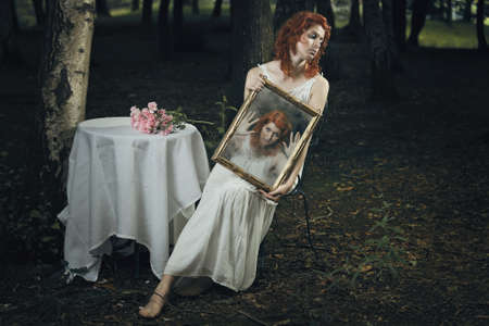 strange: Soul of a woman trapped inside a mirror in a strange forest . Dark and surreal