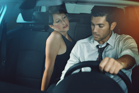 seduction: Sensual woman seducing her chauffeur. Passion and seduction concept