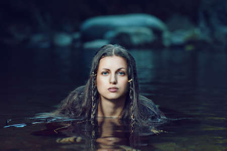 fantasy girl: Beautiful woman in dark water stream .Fantasy and fairy