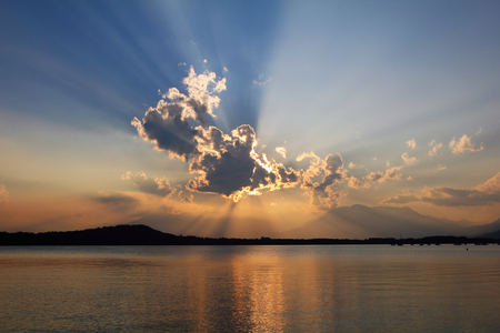 biblical: Biblical cloudscape with sunset light . Lake water reflection Stock Photo