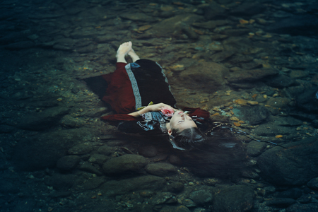 floating on water: Beautiful floating woman in dark water . Ophelia conceptual
