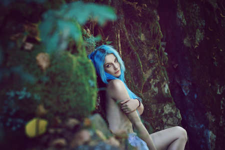 Beautiful ethereal nymph in a surreal forest . Fantasy and myth