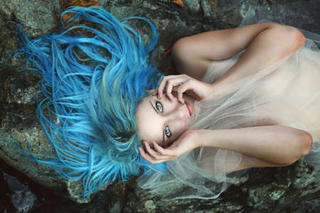 sea nymph: Beautiful river nymph posing on rocks . Fantasy and myth Stock Photo
