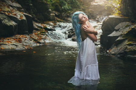 wood nymph: Beautiful romantic maiden in the stream waters. Purity conceptual