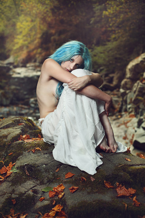 purity: Beautiful young woman posing in autumn forest . Romance and purity