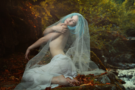 autumn colors: Romantic portrait of beautiful woman in autumn colors forest . Dreamy and ethereal