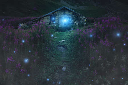 wisp: Mysterious mountain cabin surrounded by will o wisp. Fantasy and halloween Stock Photo