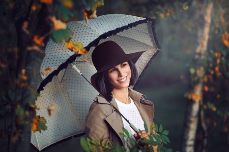 autumn young: Smiling happy woman among autumn trees . Seasonal portrait Stock Photo