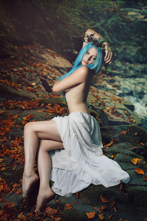 wood nymph: Beautiful queen of forest in colorful portrait . Dreamy and ethereal