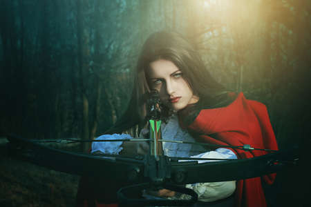 hood: Little red riding hood dangerous hunter . Fairy tale and fantasy Stock Photo